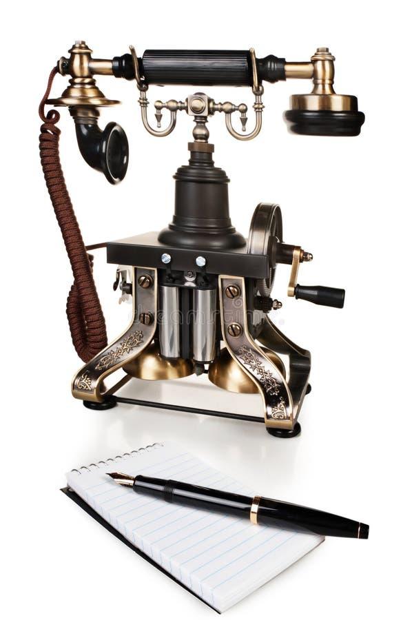 Retro telefon, pióro i Notepad, - rocznika telefonu set zdjęcie stock