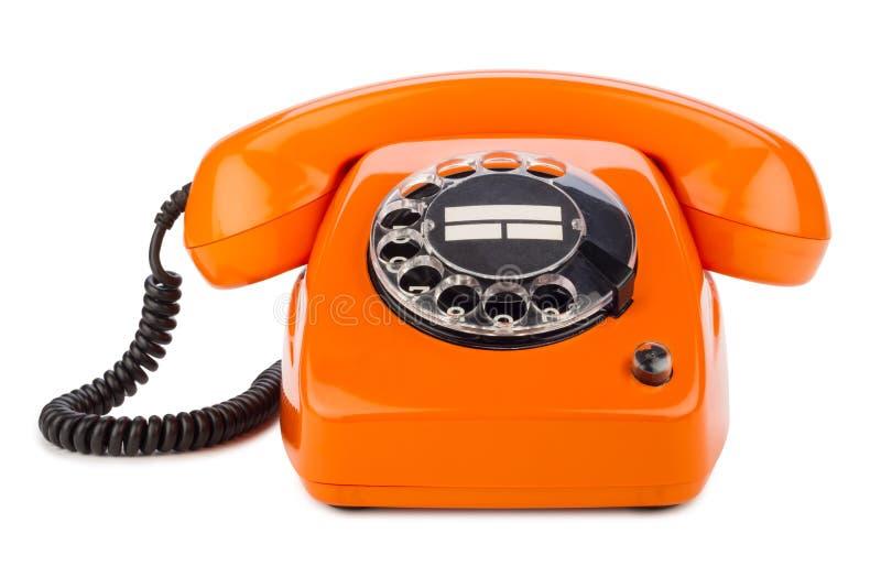 Retro telefono arancio fotografie stock libere da diritti