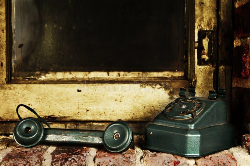 Retro telefono - fuori dal telefono dell'annata dell'amo fotografia stock