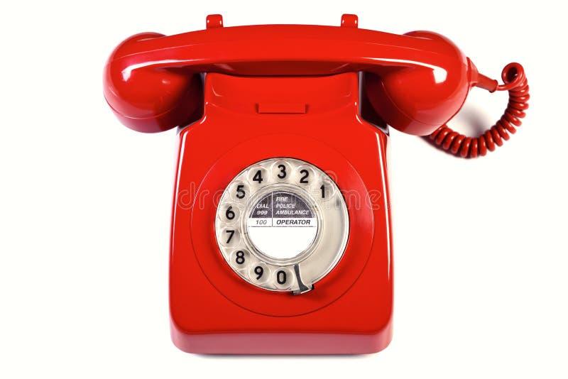 Retro telefono rosso isolato immagini stock