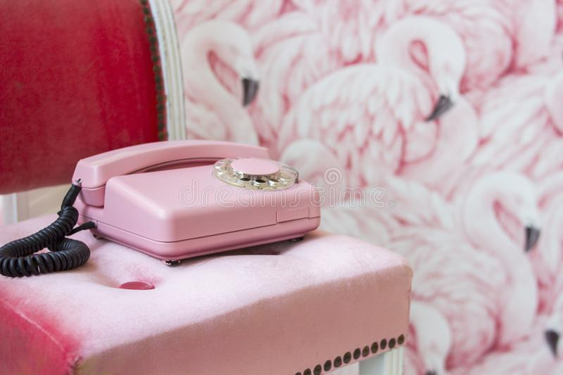 Old pink home phone. Wired vintage phone. Retro stock photos