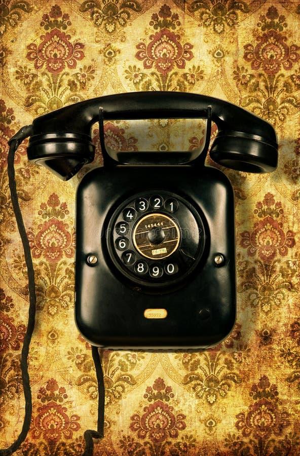 Retro telephone on vintage wallpaper royalty free stock photos