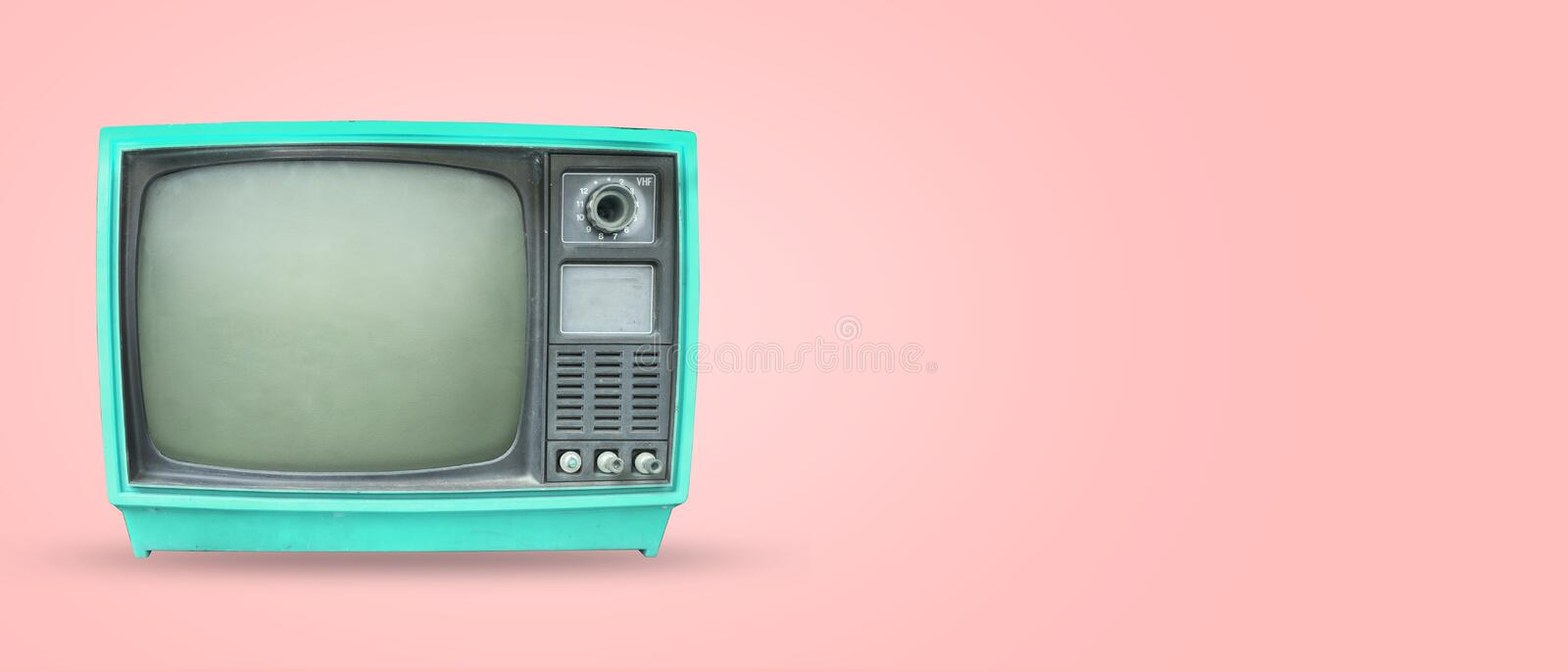 Old vintage tv on pastel color background. Retro television - old vintage tv on pastel color background. retro technology. flat lay, top view hero header royalty free stock photos