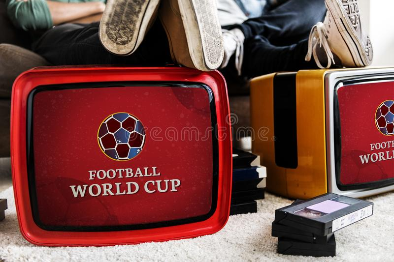 Retro televisions with a football world cup advertisement royalty free stock image