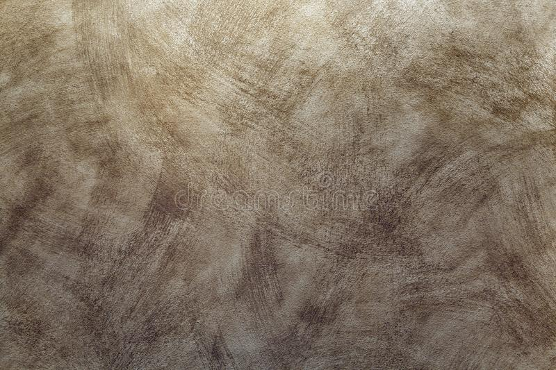 Retro texture of brush strokes on the wall - decorative coating. Brown color stock photos
