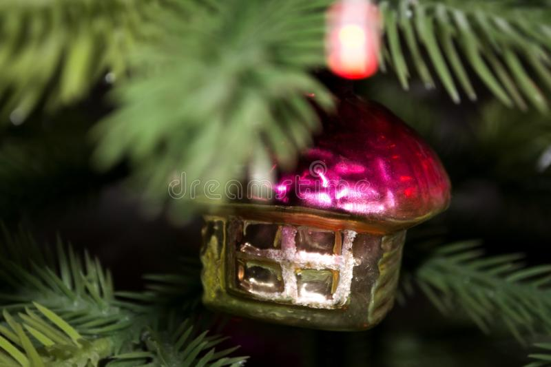 Retro toy from the USSR in the form of a house on a Christmas tree royalty free stock photography