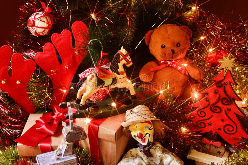 Toys Under Christmas Tree : Retro toys and gifts under a christmas tree stock photo