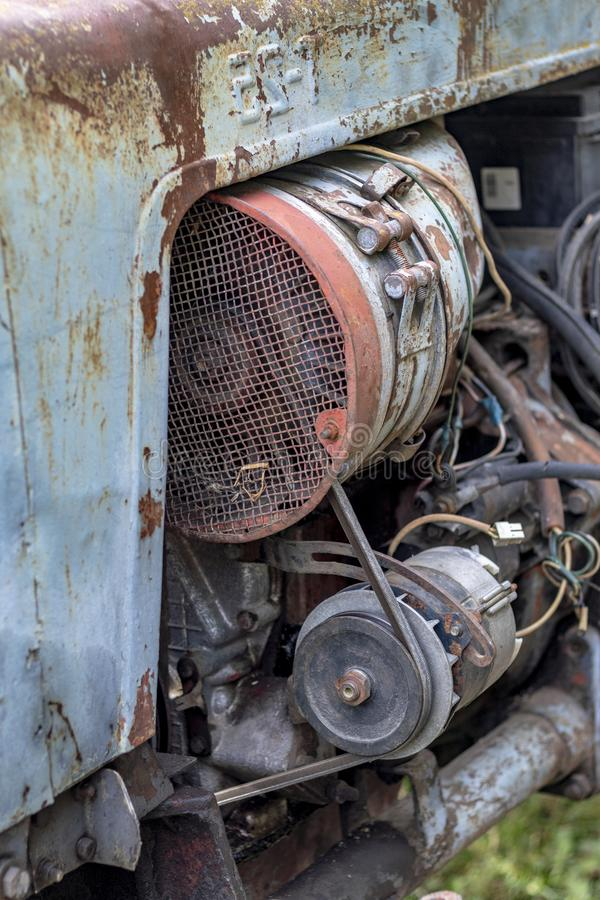 Retro tractor. t-25. breakage, oil flow in the cylinder. there is a tint. air cooling. Plant, vladimirsky, vtz, breakdown, drip, pressure, diesel, missing, no royalty free stock image