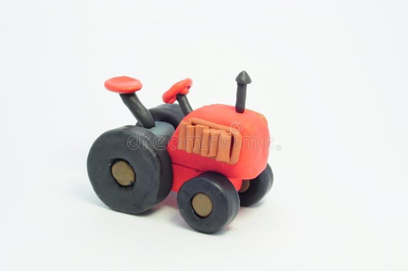 Retro- Traktor des Plasticine. lizenzfreies stockbild