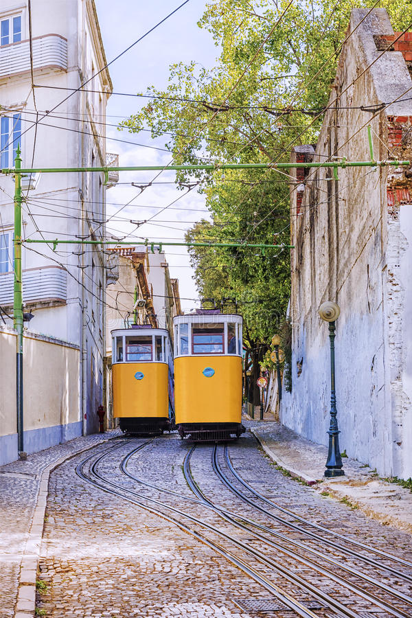 Retro tram elevator in the streets of Lisbon, Portugal stock images