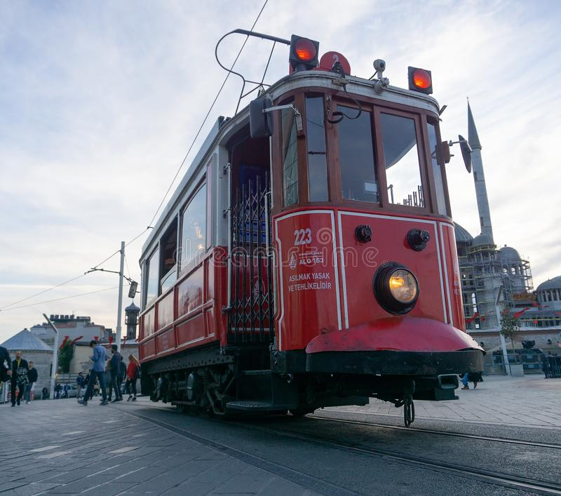 Retro tram on Taksim Istiklal Street in Istanbul, Turkey in a summer sunset.  royalty free stock photography