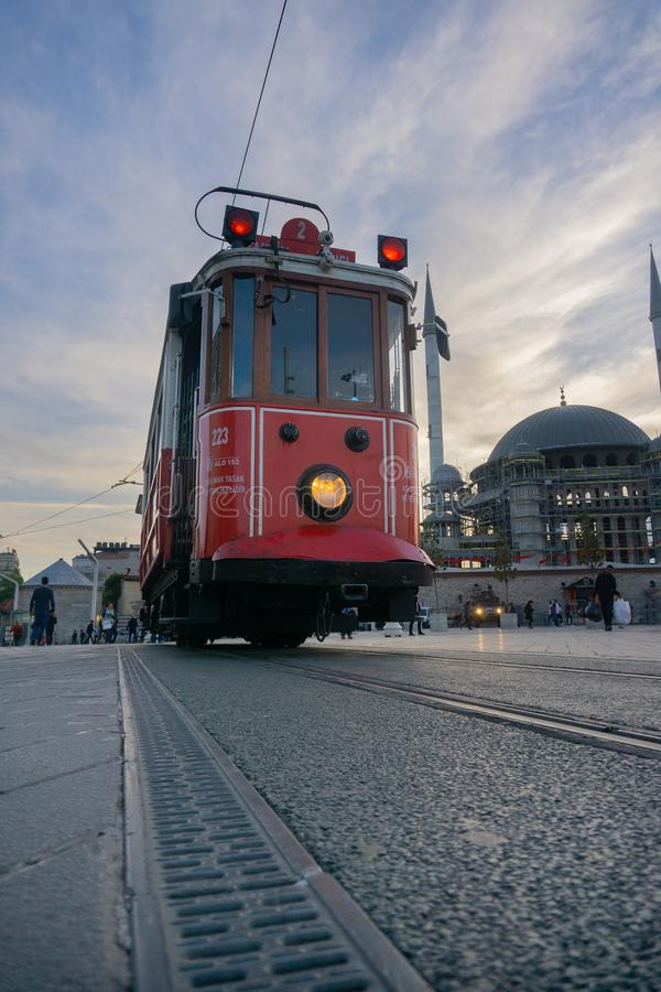 Retro tram on Taksim Istiklal Street in Istanbul, Turkey in a summer sunset.  royalty free stock image