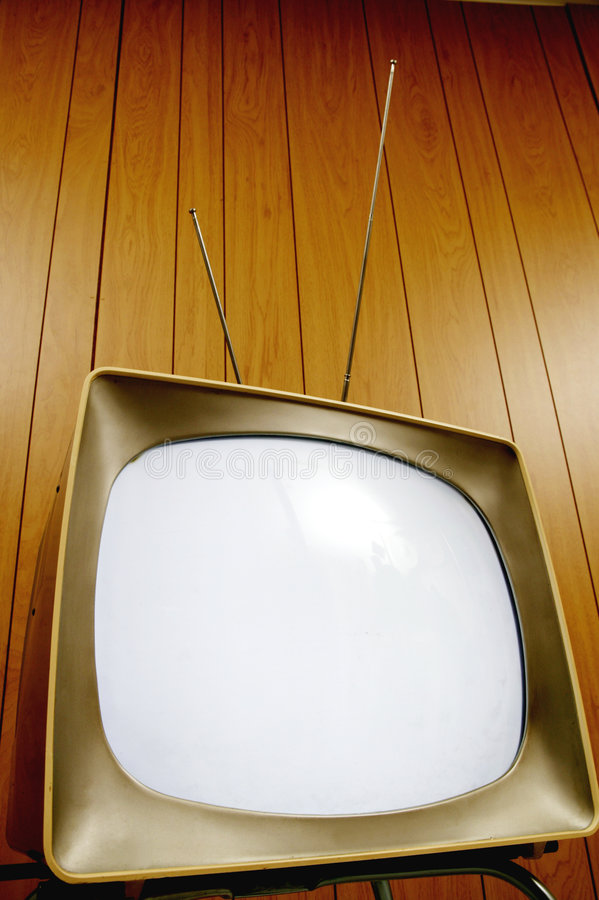 Retro TV. Atomic age television set close up against a wood paneled background stock image