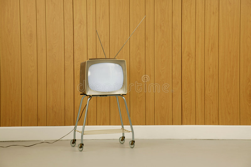Retro TV. Atomic age television set close up against a wood paneled background royalty free stock image