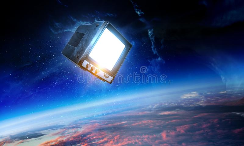 Retro TV flying in space stock images