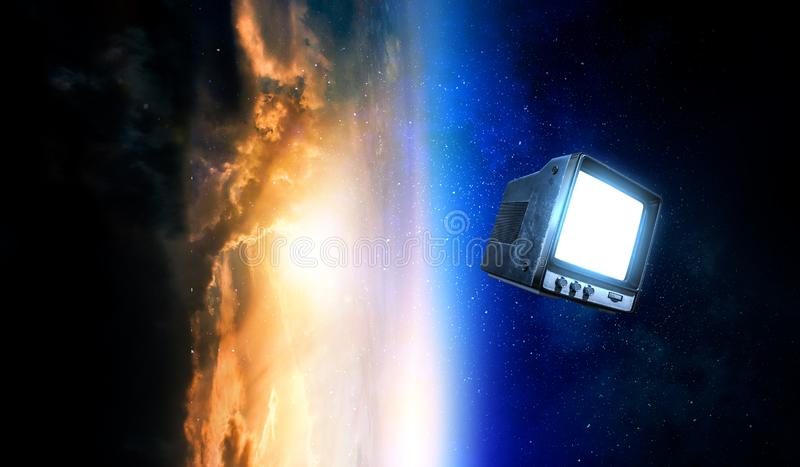 Retro TV flying in space royalty free stock image