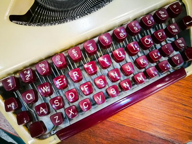 Retro typewriter keyboard with printer`s movable type in red color. stock image