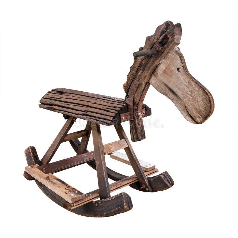 Retro vagga häst som göras från isolerat trä på vit bakgrund Trästol för barn kan rida Snabb bana arkivfoto