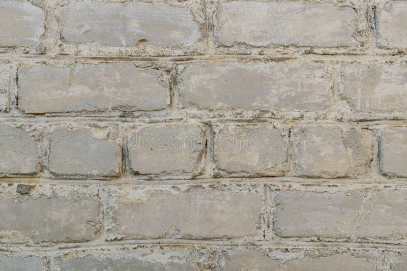 Retro Vergoelijkte Oude Bakstenen muuroppervlakte Witte Rustieke Textuur Uitstekende structuur Grungy Sjofel Ongelijk Geschilderd stock fotografie