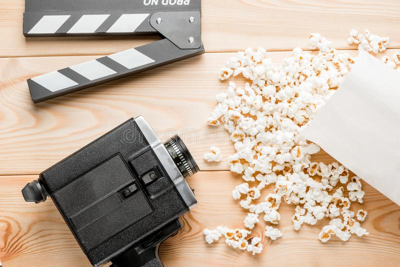 Retro video camera, video clapper and popcorn top view close-up stock image