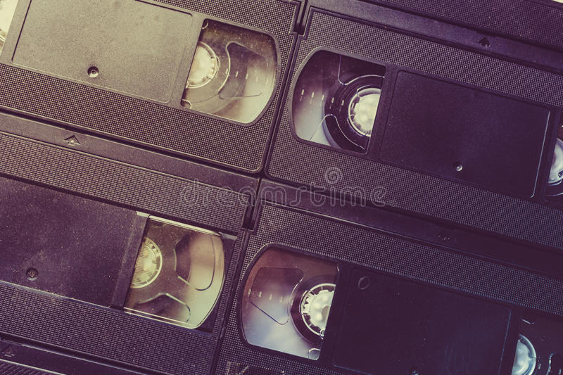 Retro video cassettes background, VHS tapes. Toned stock image