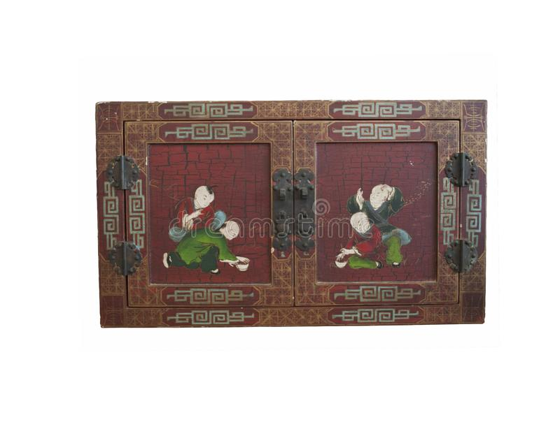Antic doors hand parted in Japanese Chinese style. Retro vintage antic piece of furniture. Japanese Chinese chest of treasure, old ancient hand painted box royalty free stock photos