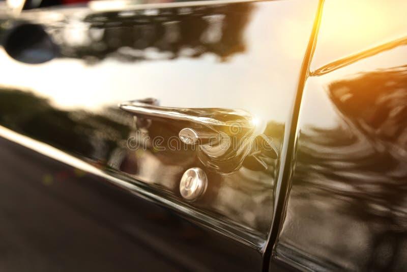 Retro vintage black car. Car door handle.  stock image