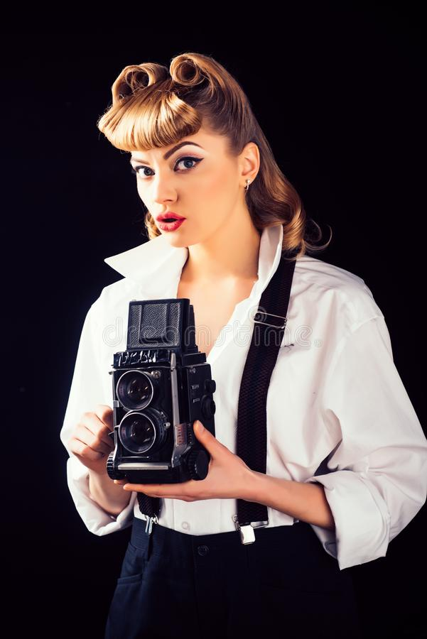 Retro vintage concept. Beautiful woman holding a camera. Old style. The best moments of life on film. royalty free stock image