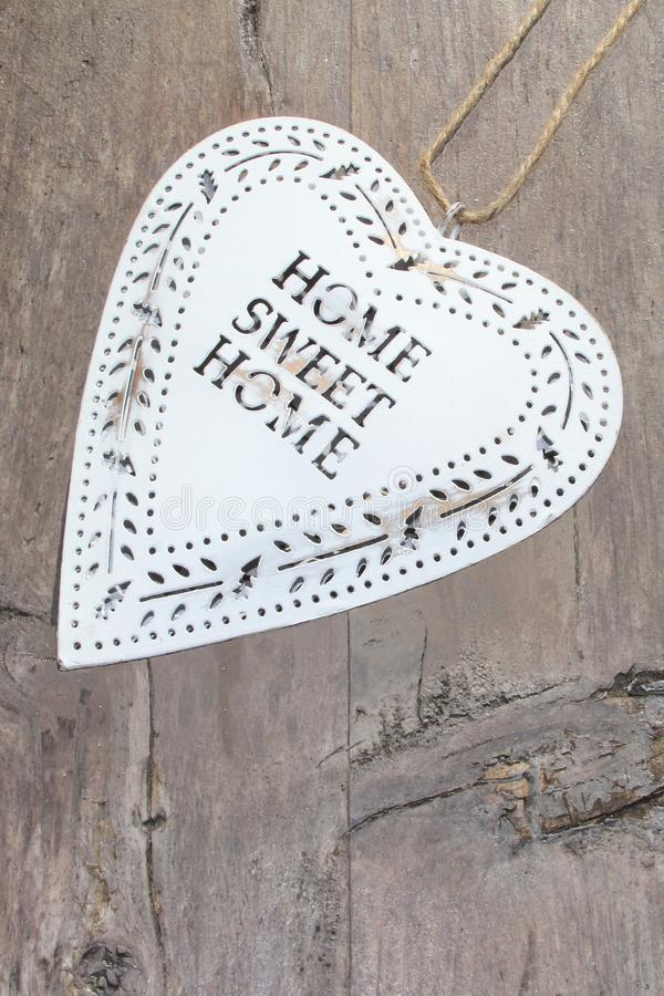 Retro vintage heart Home Sweet Home, on rustic wood stock photos
