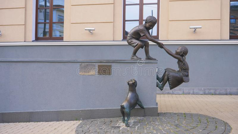 Retro vintage metal bronze Children and dog playing statue decoration art in Kazan Russia royalty free stock photo