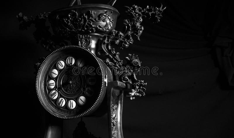 Retro vintage old clock details close up in black and white stock image