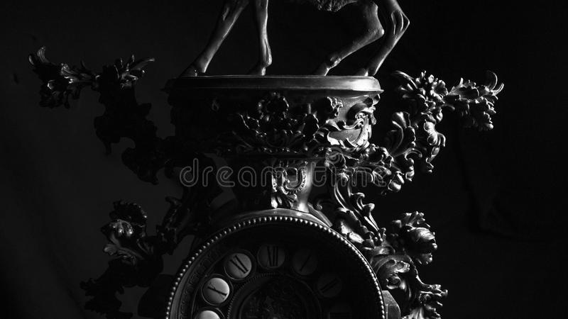 Retro vintage old clock details close up in black and white royalty free stock photo