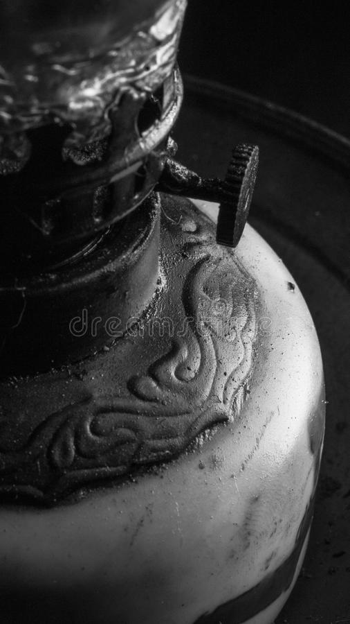 Retro vintage old oil lamp details close up in black and white stock photos