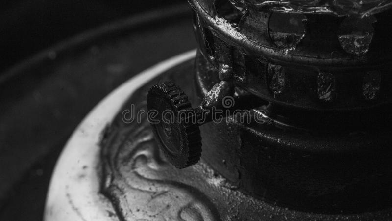 Retro vintage old oil lamp details close up in black and white stock photography