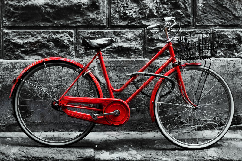 Retro vintage red bike on black and white wall. stock photography