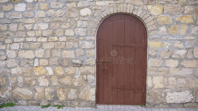 Retro vintage stone brick wall and old wooden door background.  royalty free stock photos