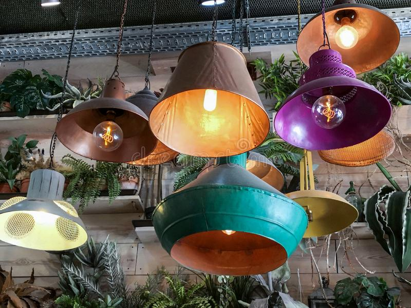 Retro vintage style lamps decorated interior room and hanging from ceiling stock photos