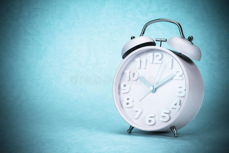 Retro and vintage style of Old fashioned alarm clock. Retro and vintage style of Old fashioned the alarm clock royalty free stock image