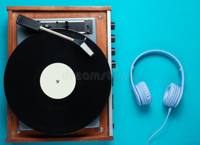 Retro vinyl record player, headphones stock photography