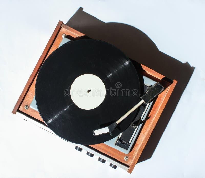 Retro vinyl turntable on white background. Photo with shadows, hard light, top view. Retro vinyl turntable on white background. Photo with shadows, hard light stock photography