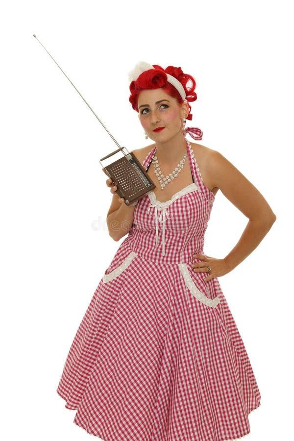 Retro vrouw met radio royalty-vrije stock foto