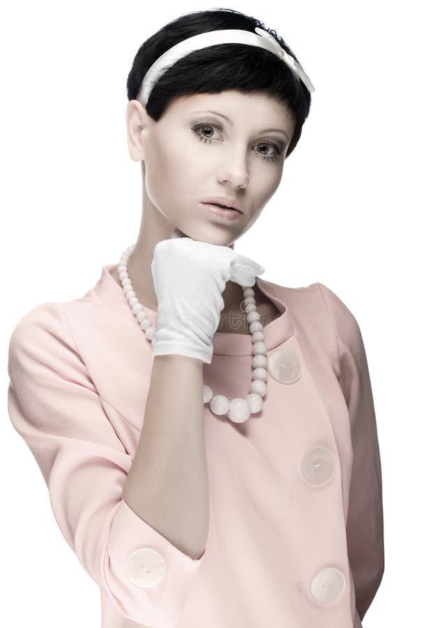 Retro vrouw in roze kledingsjaren '60 stock foto