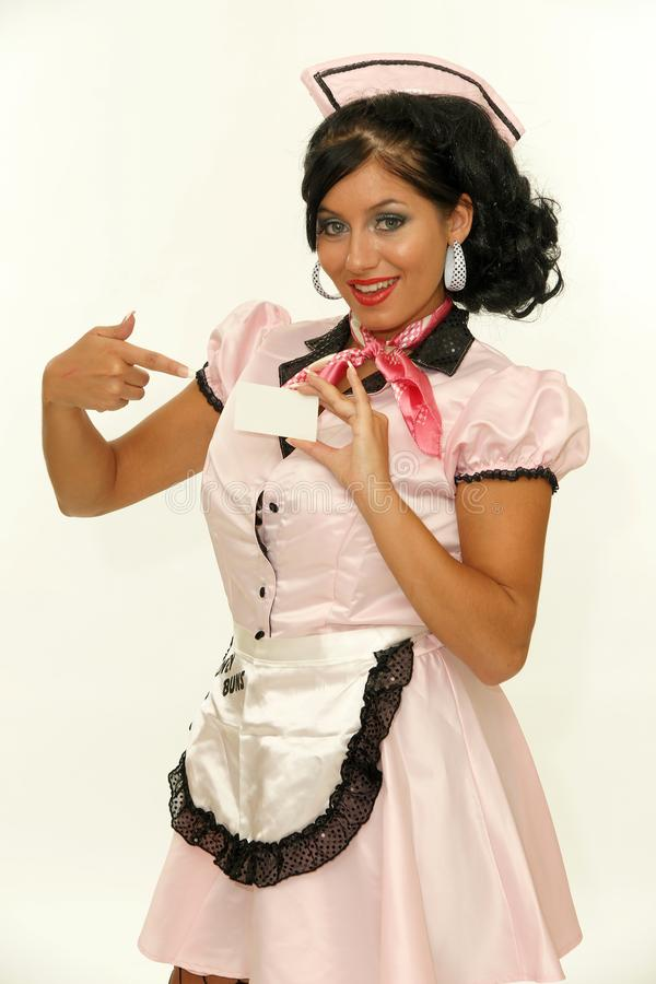 Retro Waitress showing a business card stock images