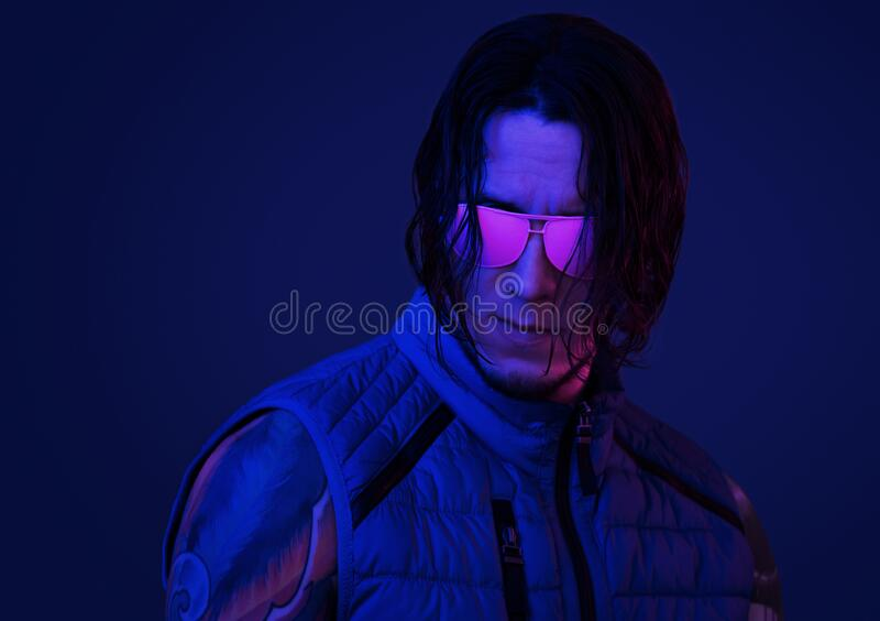 Retro wave portrait of young man in pink sunglasses. Retro wave portrait of serious young man with long hair in pink sunglasses in neon light royalty free stock image