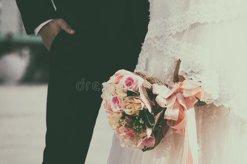 Retro wedding bouquet with the flower in hands royalty free stock photo