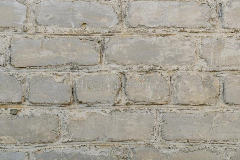 Retro whitewashed old brick wall surface. White rustic texture. Vintage structure. Grungy shabby uneven painted plaster stock photography