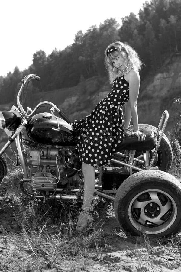Retro Woman On A Bike Stock Photo