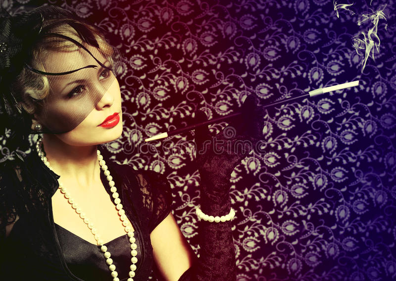 Retro Woman with Cigar. Portrait of Fashion Beautiful Blonde royalty free stock photos