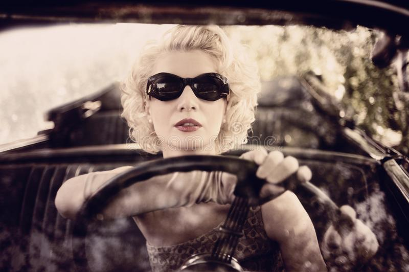 Download Retro woman driving a car stock photo. Image of girl - 27591956