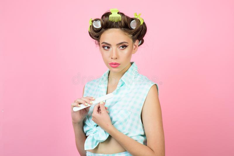 Retro woman with fashion makeup and hair. happy girl grooming in morning. beauty salon and hairdresser. Pin up girl. Vintage housewife woman make manicure royalty free stock photos